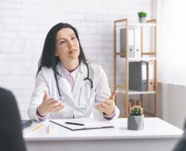 Physician explaining symptoms to patients during consultation